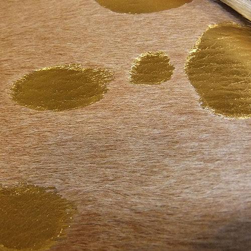 goud op beige effect koeienhuid